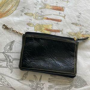 tusk black gold interior wristlet
